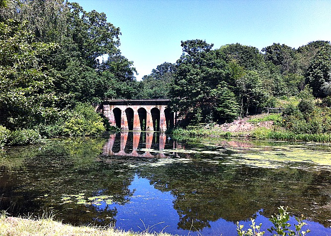 Hampstead Heath's historic Red Arches bridge and secluded pond is a perfect spot for a romantic retreat close to Hampstead properties